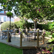 Garden with decked area at Sonachan House B&B Paignton