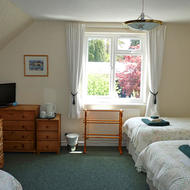 Family room (for 5) at Sonachan house B&B with views over rear garden and out over Torbay towards Torquay